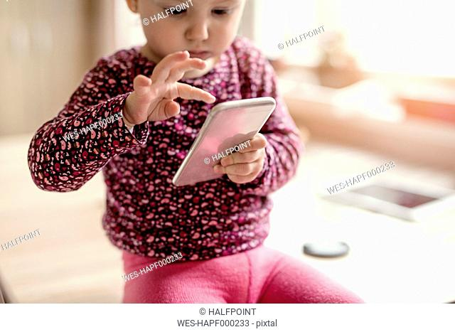 Toddler playing with smartphone