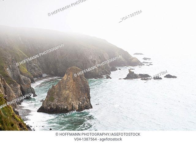 Cliffs and coastline in the fog, Ireland, Europe