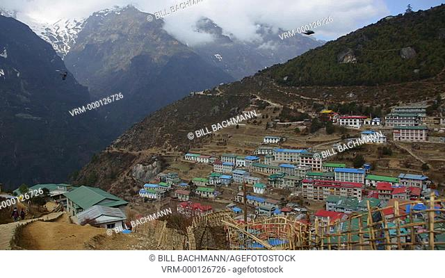 Nepal Himalayas The village of Namche Bazarre, shot from a view point at the top of the village, with the Himalayas in the distance remote Mt Everest
