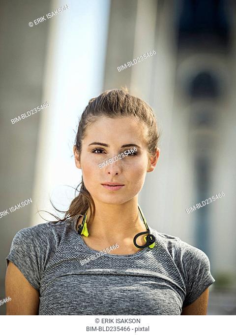 Serious Caucasian woman posing under overpass