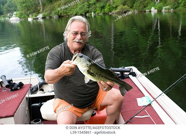 man with a 5LB bass that was caught on Laurel Lake, in Irving, MA, USA