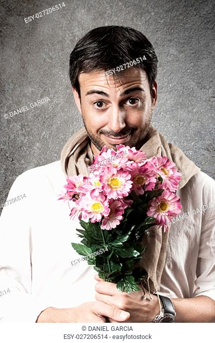 Man in love with a bouquet of flowers. Vertical image