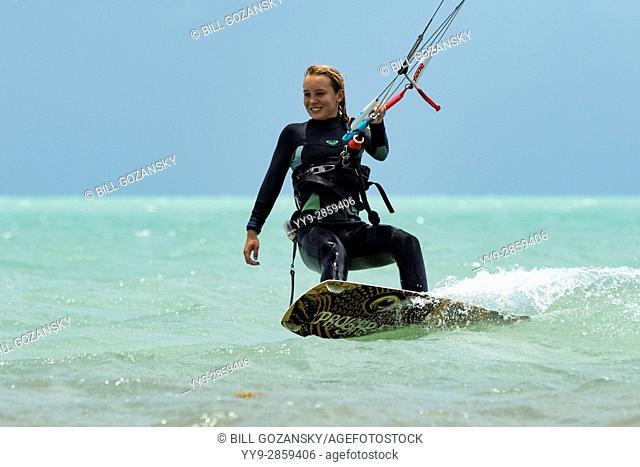 Young girl kitesurfing at Coco Plum Beach, Marathon Key, Florida, USA