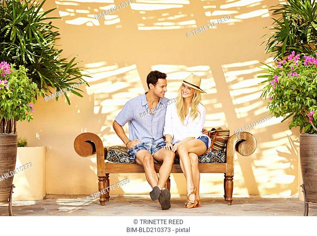 Couple sitting on patio bench