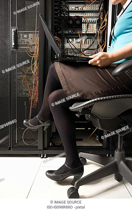 A female computer technicians legs