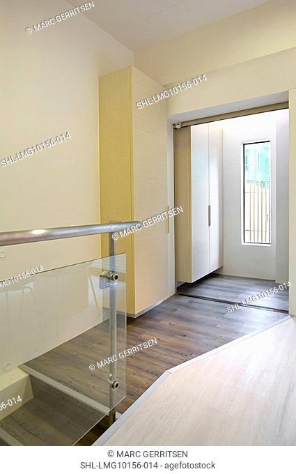 Hardwood floor in hallway and staircase