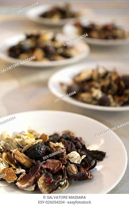 assortment of dried herbal medicines of white dish