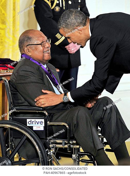 US President Barack Obama (R) presents a 2012 National Medal of Arts to Ernest Gaines, for his contributions as an author and teacher
