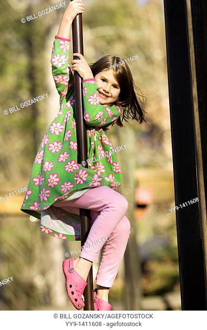 Young girl sliding on pole at playground - Franklin Park - Brevard, North Carolina