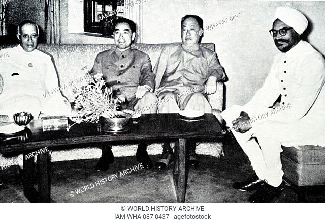 Photograph of Indian and Chinese officials meeting to discuss border disputes. Left to right: Jawaharlal Nehru, Premier of India; Chou En-lai