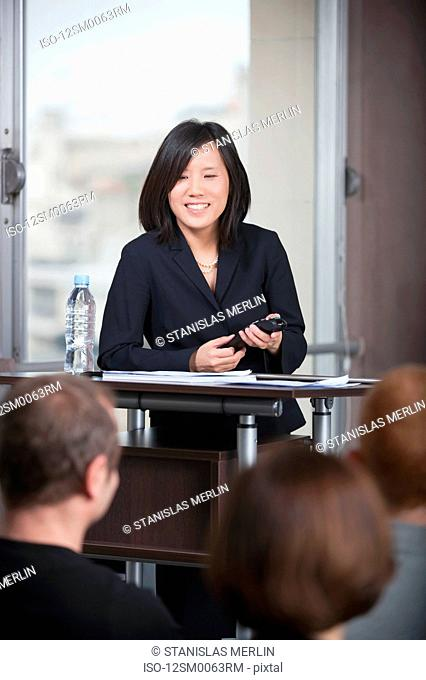 Woman speaking to business group