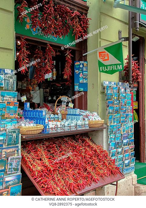 Red chillies and turquoise postcards for sale at tourist kiosk near Budapest Cathedral, Budapest, Hungary