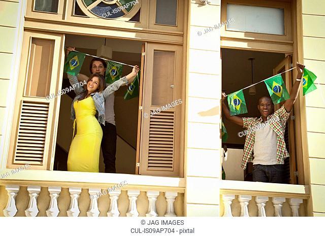 Students celebrating with Brazilian flags, Rio de Janeiro, Brazil