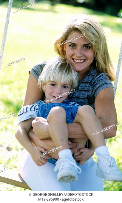 mother with son on a swing