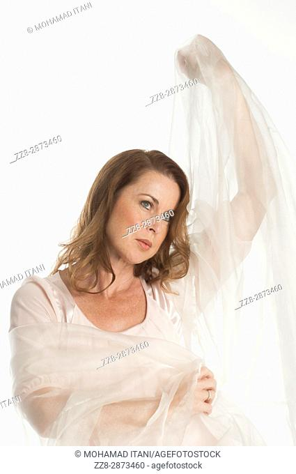 Beautiful mature woman covered with chiffon material