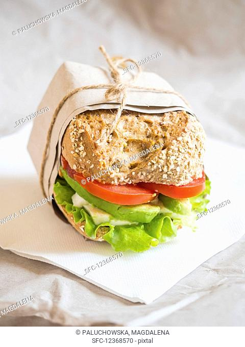Fresh vegetarian goat cheese and vegetable sandwich on a whole grain bread