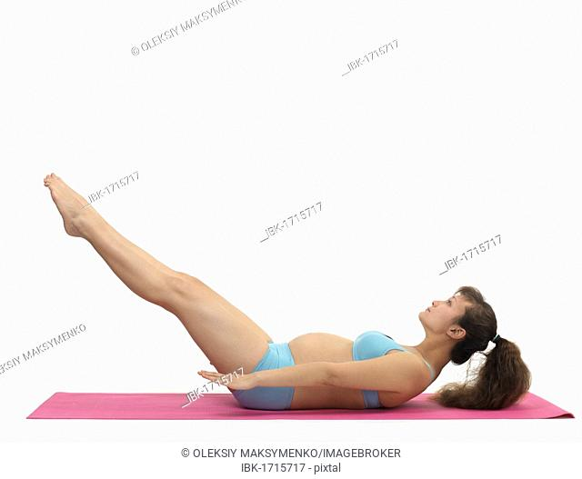 Pregnant young woman doing Pilates workout