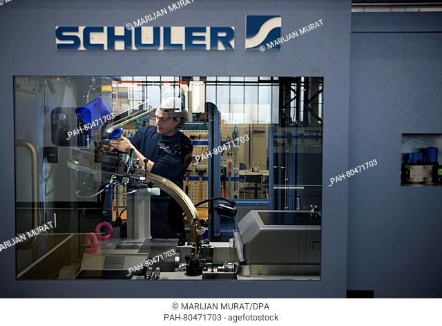 COIN IMPRINTING AT SCHULER (3/3/2016) - Newsworthy Images at age