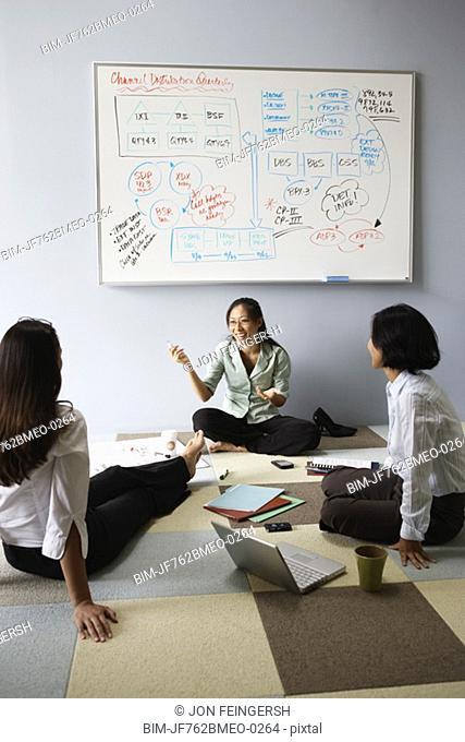 Asian businesswoman having meeting on floor