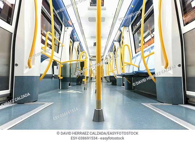 Inside an empty subway train in Madrid, Spain. This Metro train is the newest of the narrow line trainsets