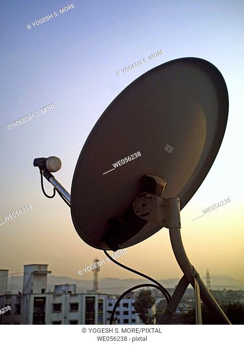 A dish antena of a television set on a building terrace  Pune, Maharashtra, India