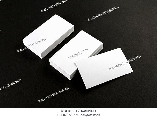 Blank business cards on black background. Template for ID