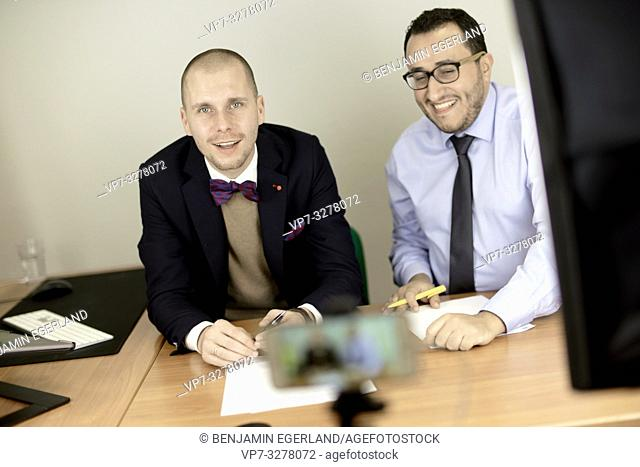 business men at conference, lawyers consulting at online live stream, in Cottbus, Brandenburg, Germany