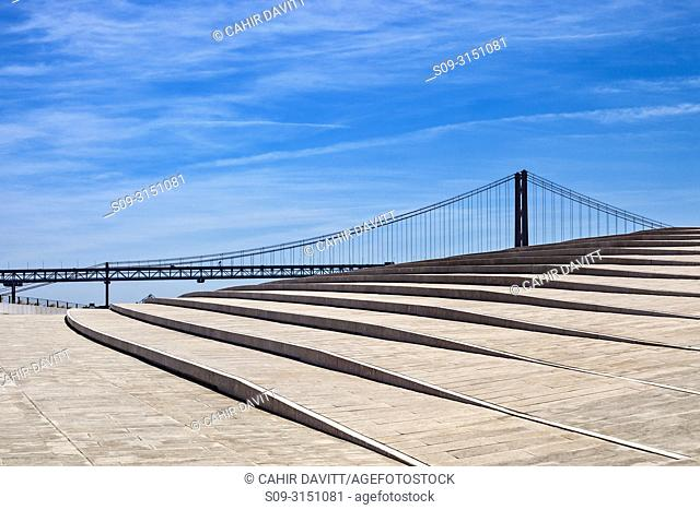 The MAAT (Museum of Art, Architecture and Technology), on the Tagus River, designed by Amanda Levete Architects, with the Tagus River suspension bridge in the...