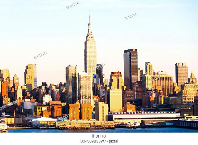 Cityscape with Hudson river and Empire State building, New York, USA
