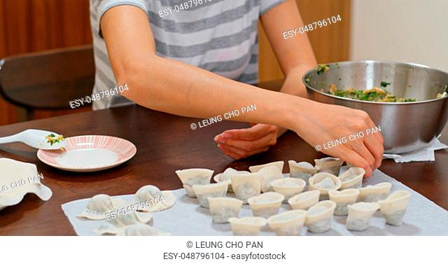Woman make of chinese meat dumpling at home