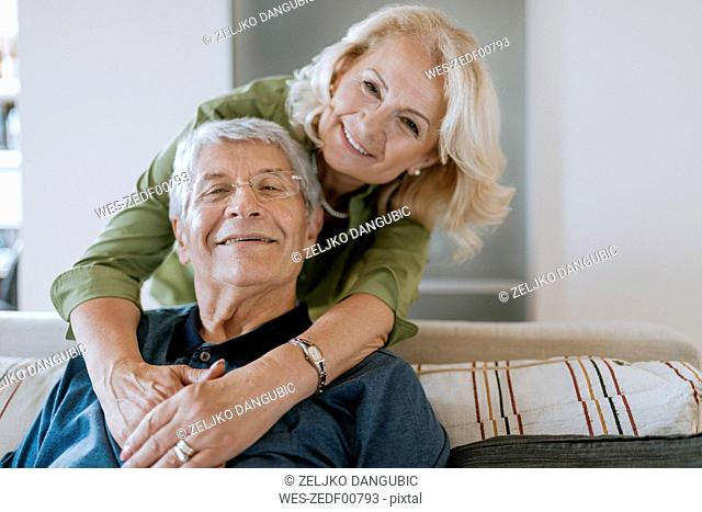 Portrait of affectionate senior couple at home
