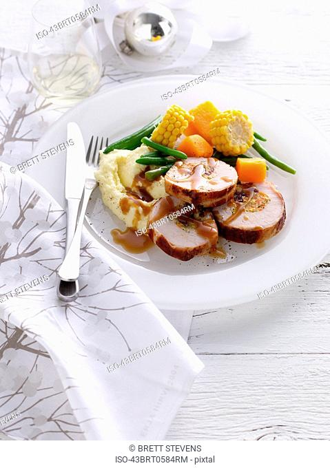 Plate of stuffed pork with vegetables