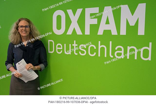 The managing director of aid organisation Oxfam Germany, Marion Lieser, leans against wall which reads: 'Oxfam Germany', prior to the presentation of a...