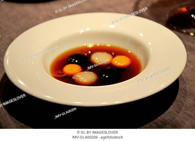 Broth, Parmesan, Egg and Truffle served on a plate