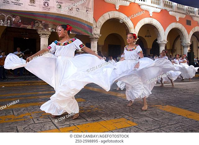Young female dancers in traditional dress during a Jarana performance at sunday activities, Merida, Riviera Maya, Yucatan Province, Mexico, Central America