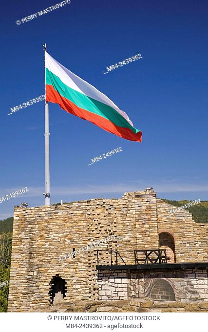 Bulgarian flag and old stone wall fortification ruins at the Tsarevets Fortress, Veliko Tarnovo, Bulgaria, Eastern Europe