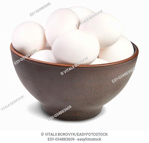 White Eggs Into Ceramic Bowl Isolated On White Background
