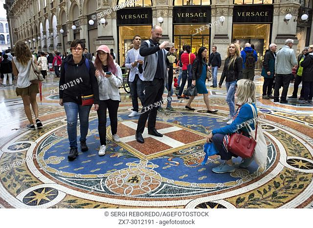Vittorio Emanuele gallery interior, Milan, Italy. Coat of arms of the House of Savoy depicted on the mosaic floor in the Galleria Vittorio Emanuele II in Milan