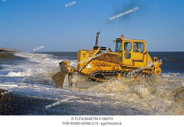 Construction - Bulldozer rebuilding Sea Defences, Cley and Salthouse, North Norfolk, England