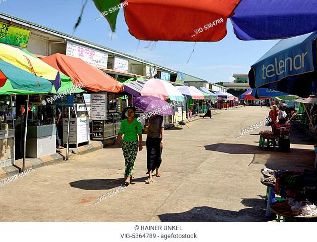 MMR , MYANMAR / BURMA / BIRMA : Two customers on the market in the capital Nay Pyi Taw , 04.11.2015 - Nay Pyi Taw, Nay Pyi Taw, Myanmar, 04/11/2015