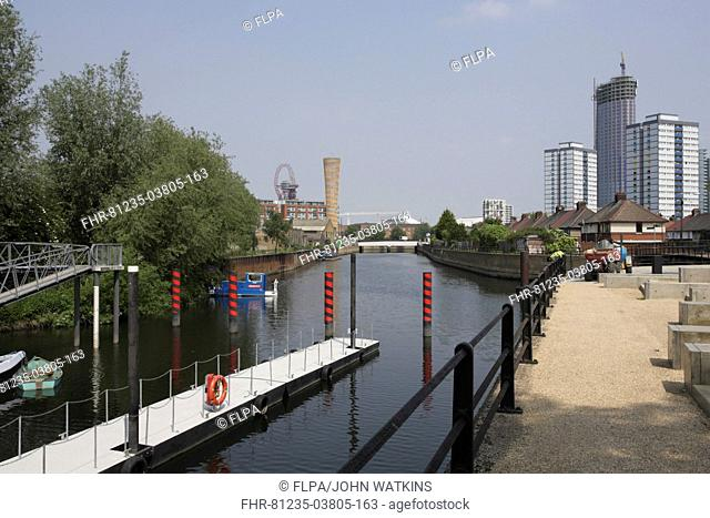 Canal with walkway alongside for pedestrians and cyclists to park entrance, Olympic Park, East London, England, may 2012
