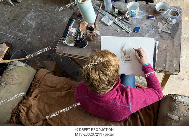 Female artist making sketch in art studio, Bavaria, Germany