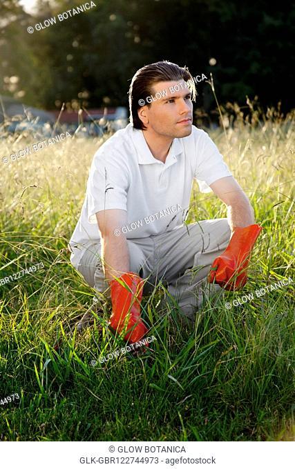 Man crouching in grass