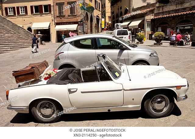 A wedding car at the Piazza della Repubblica, Republic Square, Cortona, Province Arezzo, Tuscany, Italy, Europe