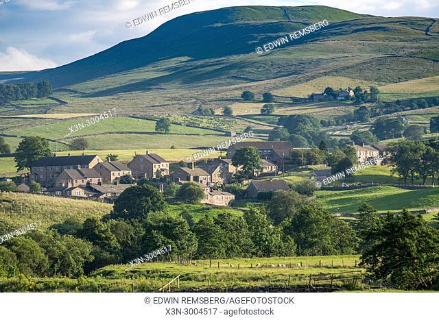 Residential neighborhood nestled into the hillside, Yorkshire Dales, UK