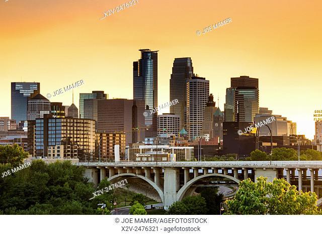 Minneapolis skyline and Tenth Avenue bridge with orange storm light