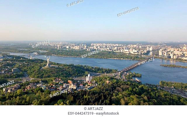Panoramic view of the city of Kiev. The Pechersky district is part of the Botanical Garden, the Dnieper River with the Paton Bridge and the Metro Bridge