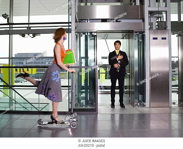 Businessman standing in elevator doorway