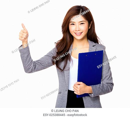 Young Asian businesswoman thumbs up with clipboard
