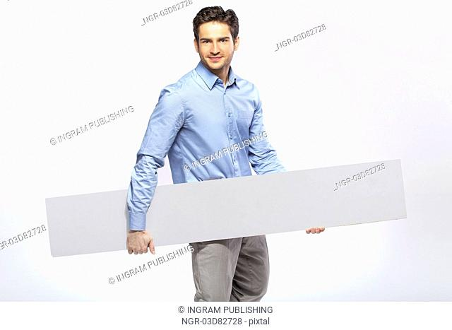 Picture of handsome guy in suit with a blank board